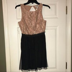 Pink lace blush  and black dress.